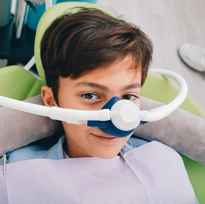 Young boy with nitrous oxide sedation dentistry mask